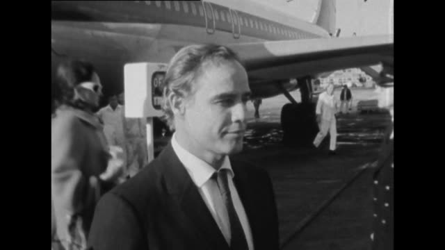 sequence showing marlon brando arriving at london airport. - actress stock videos & royalty-free footage