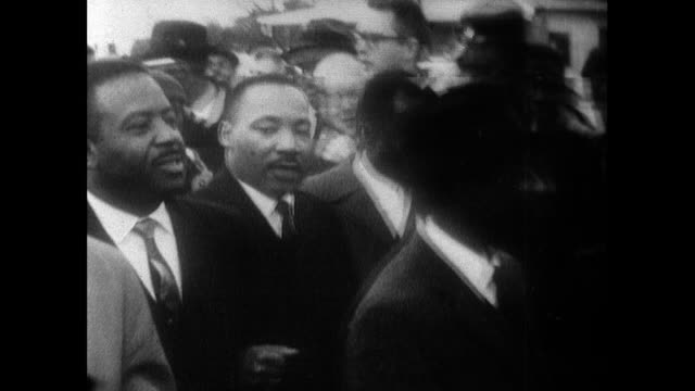 sequence showing martin luther king and his supporters marching to selma over the edmund pettus bridge on 'turnaround tuesday' 9th march 1965 ws... - voting rights stock videos & royalty-free footage