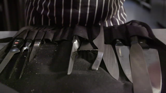 sequence showing meat preparation with knives and at street food stalls, uk. - apron stock videos & royalty-free footage