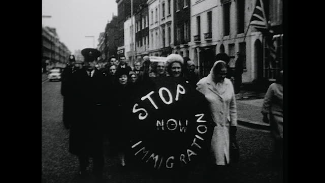 sequence showing members of the immigration control association delivering a petition to enoch powell's house, supporting his call to halt... - racism stock videos & royalty-free footage