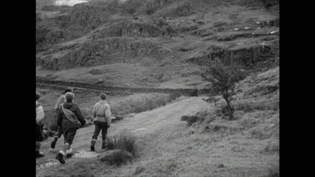 sequence showing members of the raf mountain rescue team setting out on a training mission in snowdonia. - snowdonia stock videos & royalty-free footage