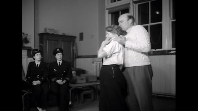 sequence showing members of the welsh association of training corps for girls taking part in a judo lesson - self defense stock videos and b-roll footage