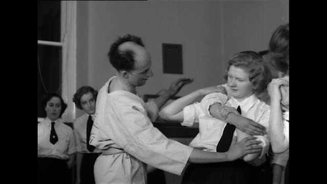 Sequence showing members of the Welsh Association of Training Corps for Girls taking part in a judo lesson