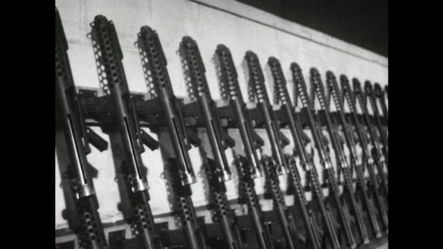 vidéos et rushes de sequence showing men assembling the new sterling submachine guns in a factory - armement