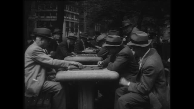 Sequence showing men playing chess at Washington Square park