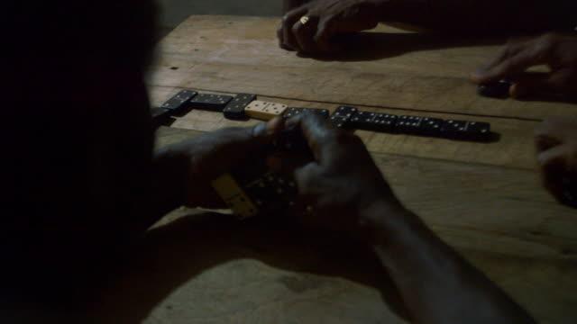 stockvideo's en b-roll-footage met sequence showing men playing dominoes in nicaragua. - spelletjesavond