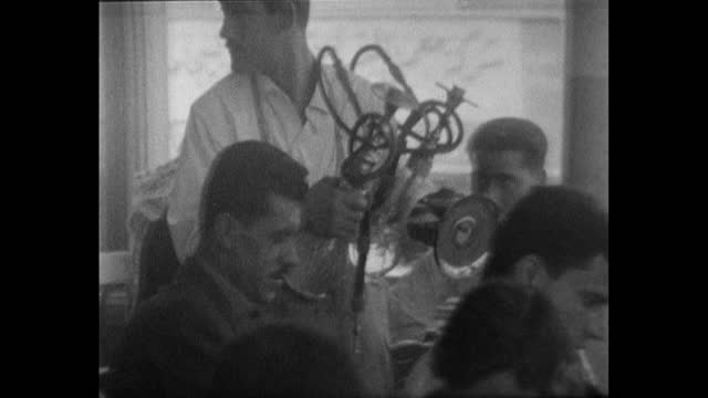 sequence showing men socialising and relaxing inside a coffee shop in amman, jordan; 1967. male waiter walks past customers carrying a hookah pipe.... - one boy only stock videos & royalty-free footage
