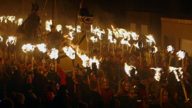 sequence showing men with flaming torches processing as part of up helly aa, the viking festival in lerwick on the shetland islands, scotland, uk. - viking stock videos and b-roll footage