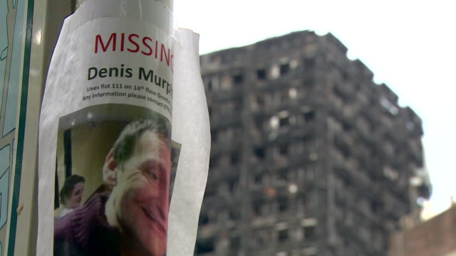 sequence showing missing posters for those in grenfell tower at the time of the fire west london - poster stock videos & royalty-free footage