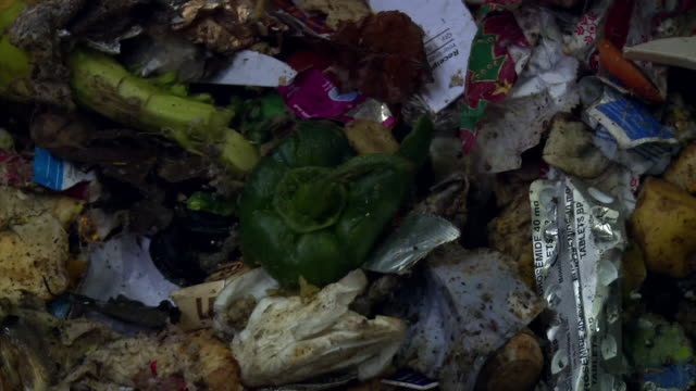 sequence showing mixed rubbish, much of it food waste, at a waste processing plant, uk. - food stock videos & royalty-free footage
