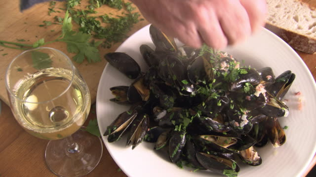sequence showing mussels dish being prepared - tradition stock videos & royalty-free footage
