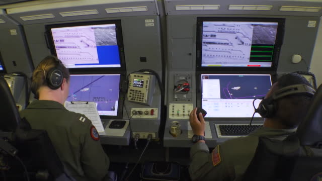sequence showing naval officers monitoring chinese military base onboard a us navy reconnaissance flight over the south china sea - south america stock videos & royalty-free footage