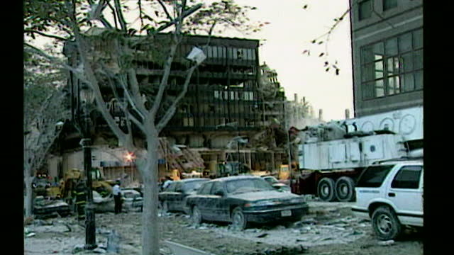 vidéos et rushes de sequence showing nearby buildings that have been destroyed by the fall of the world trade centre towers on the day after the attack; new york,... - style des années 2000