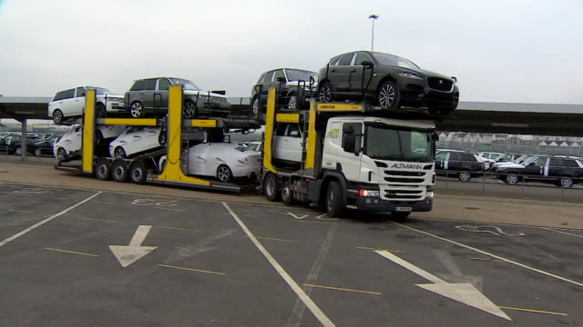 sequence showing newly manufactured cars being loaded onto shipping freights in southampton, uk - loading stock videos & royalty-free footage