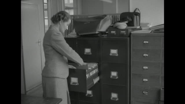 sequence showing office staff finishing up their duties at the end of a working day - after work stock videos & royalty-free footage