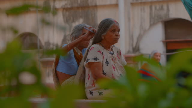Sequence showing older people who live in a so-called 'death hotel', which makes the chance of a sought-after Hindu burial in the holy city of Varanasi on the banks of the Ganges more likely, Uttar Pradesh, India.