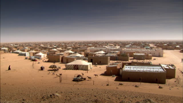 sequence showing one of the sahrawi refugee camps situated in the tindouf province of algeria. - refugee camp stock videos & royalty-free footage