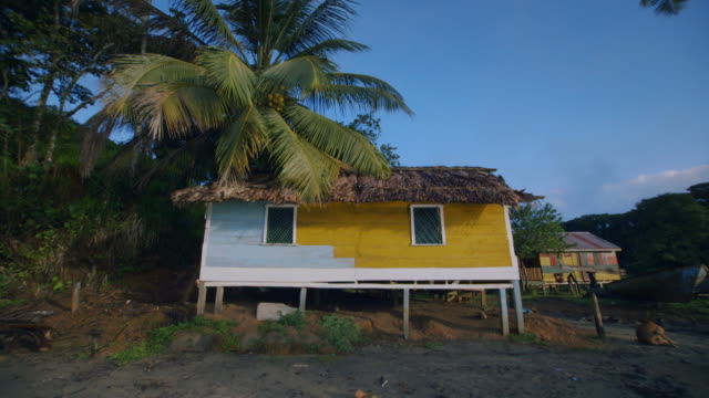 Sequence showing one-storey houses on stilts at Monkey Point on the Caribbean coastline in Nicaragua.