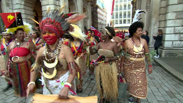 sequence showing pacific islanders singing and dancing in central london prior to the opening of the oceania exhibition - indigenous culture stock videos & royalty-free footage