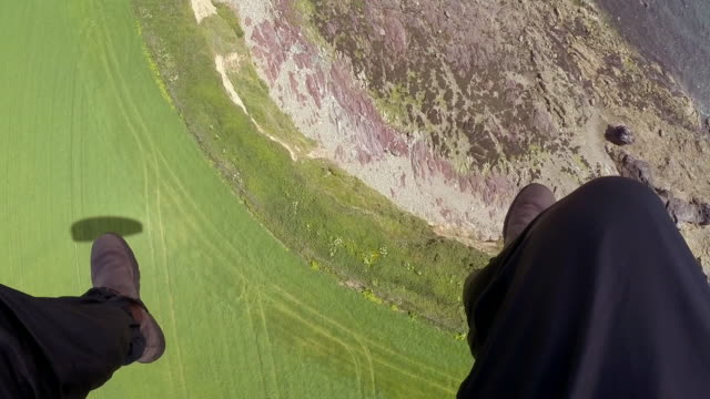 sequence showing paramotorists in flight over bannow bay in county wexford, republic of ireland. - paragliding stock videos & royalty-free footage