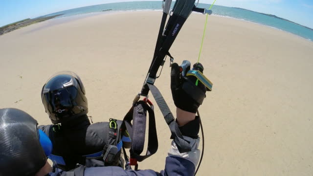 sequence showing paramotorists landing on bannow bay in county wexford, republic of ireland. - parachute stock videos & royalty-free footage