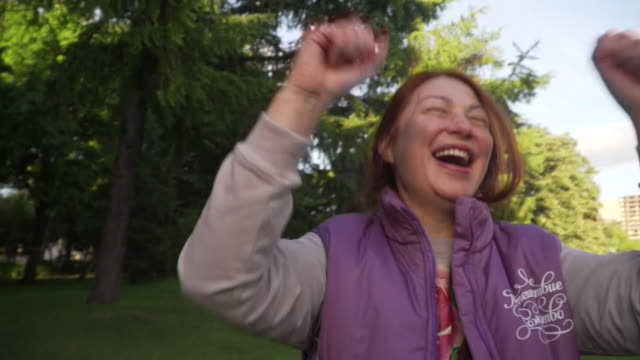 sequence showing participants at a 'laughter yoga' session in moscow - trust stock videos & royalty-free footage