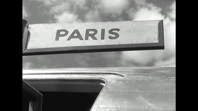 sequence showing passengers walking across an airfield to board a plane to paris - 1950 stock videos & royalty-free footage