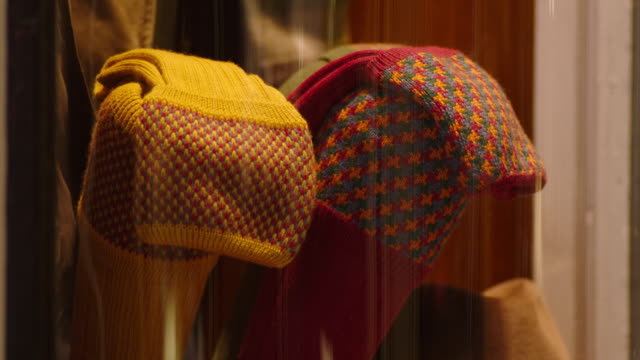 vídeos de stock, filmes e b-roll de sequence showing patterned woolly socks on display in a jermyn street shop window, london, uk. - roupa quente