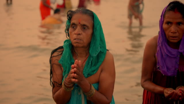 sequence showing people bathing in the waters off sagar island during the gangasagar mela, west bengal, india. - washing face stock videos & royalty-free footage