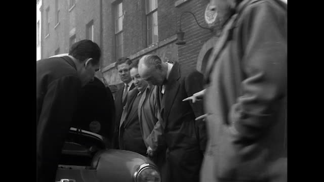 stockvideo's en b-roll-footage met sequence showing people browsing second hand cars at a car auction in london. - 50 seconds or greater