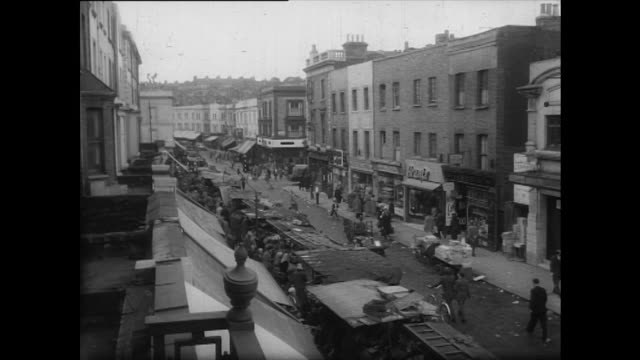 sequence showing people browsing the stalls of portobello road market - 1950 stock videos and b-roll footage
