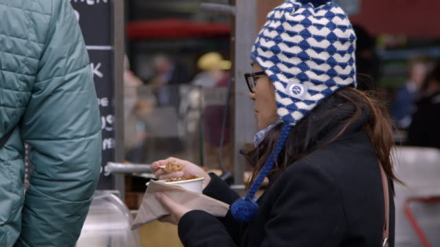 sequence showing people eating meaty street food at a london market, uk. - eating stock videos & royalty-free footage