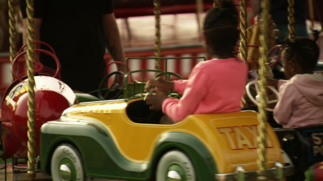 sequence showing people enjoying the attractions at a travelling fairground. - bumper car stock videos & royalty-free footage