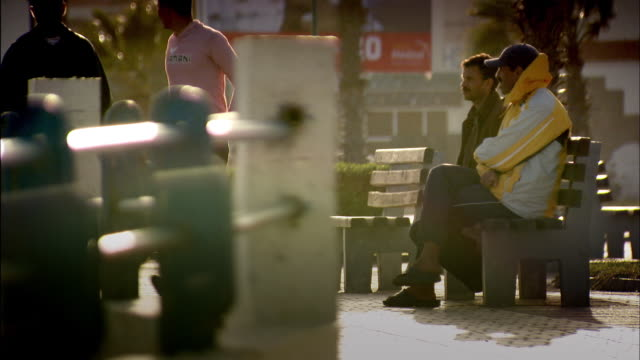 stockvideo's en b-roll-footage met sequence showing people going about their lives in the city of dakhla, western sahara. - kleding
