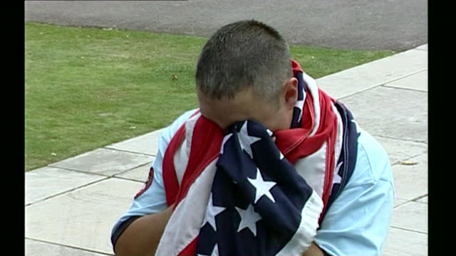 sequence showing people in silent remembrance during the first anniversary memorial event held for 9/11 victims at the us embassy in grosvenor... - national flag stock videos & royalty-free footage