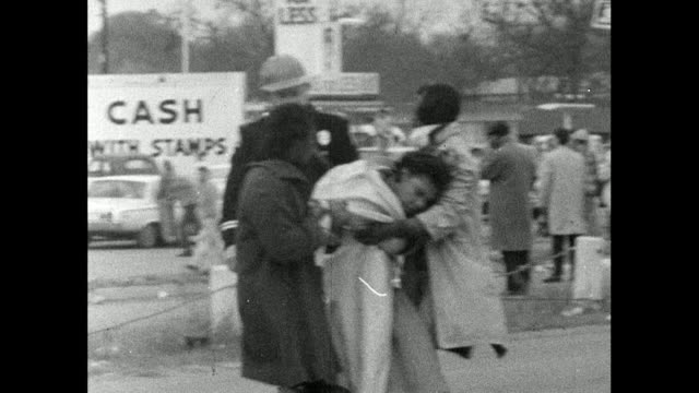 stockvideo's en b-roll-footage met sequence showing people injured during the selma marches on bloody sunday - unidentifiable person is carried off the road to safety by three others /... - 1965
