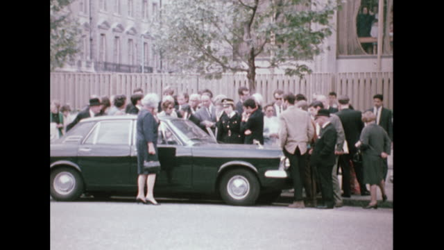 sequence showing people listening to radio broadcasts on the death of robert kennedy outside the us embassy in london - assassination stock videos & royalty-free footage
