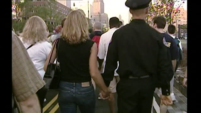 sequence showing people marching together in new york city in memory of the 9/11 victims and to mark the first anniversary of the terrorist attacks;... - surface level stock videos & royalty-free footage