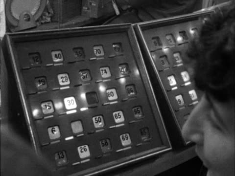 Sequence showing people playing bingo at a fairground sideshow