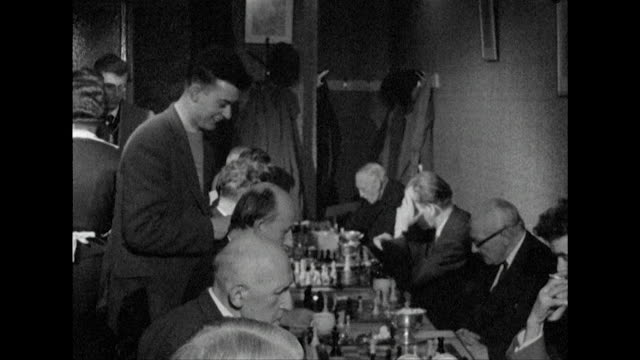 Sequence showing people playing chess at the 'En Passant' coffee bar London