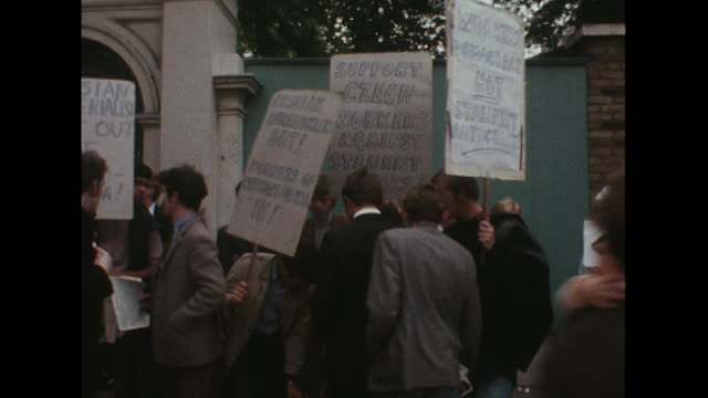 Sequence showing people protesting against the Russian invasion of Czechoslovakia outside the Russian embassy in London