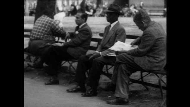 Sequence showing people relaxing in Washington Square park