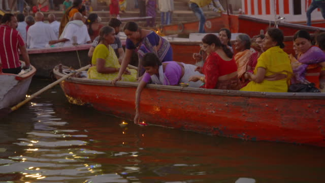 sequence showing people releasing diyas from boats on the ganges, varanasi, uttar pradesh, india. - sari stock videos & royalty-free footage