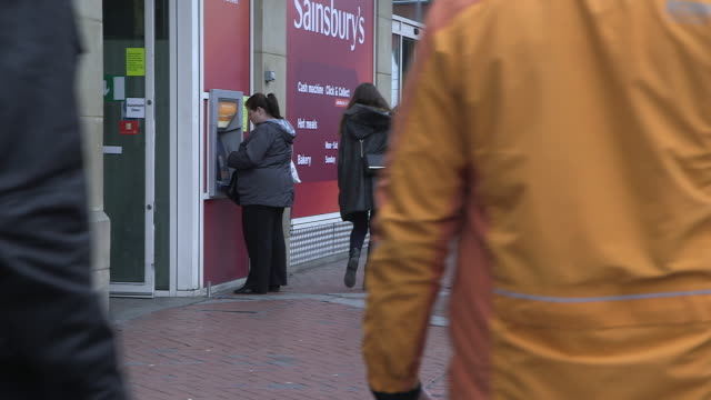 sequence showing people using cash machines on reading's broad street, england, uk. - berkshire england stock videos and b-roll footage