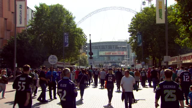 Sequence showing people walking into an NFL International Series game held at Wembley Stadium amid controversy over remarks that Donald Trump has...