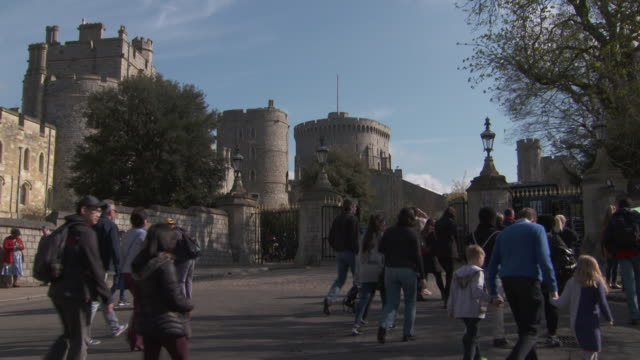 sequence showing people walking towards windsor castle windsor uk fkau104l clip taken from programme rushes aezq152y - windsor england stock videos and b-roll footage