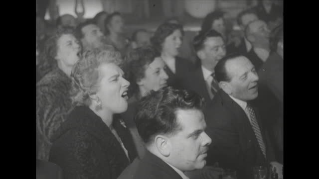 Sequence showing peoples reactions to watching a wrestling match