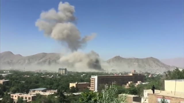 sequence showing plumes of smoke rising from a bomb blast in the centre of kabul and the resulting damage to a building afghanistan nnbz102a ae... - kabul stock-videos und b-roll-filmmaterial