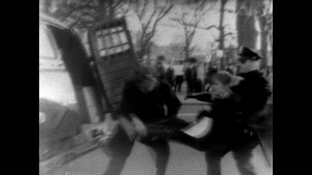 vídeos de stock, filmes e b-roll de sequence showing police arresting sit-in demonstrators outside the white house in washington d.c. who are protesting in sympathy with the selma... - 1965