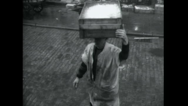 Sequence showing porters working at Billingsgate market London